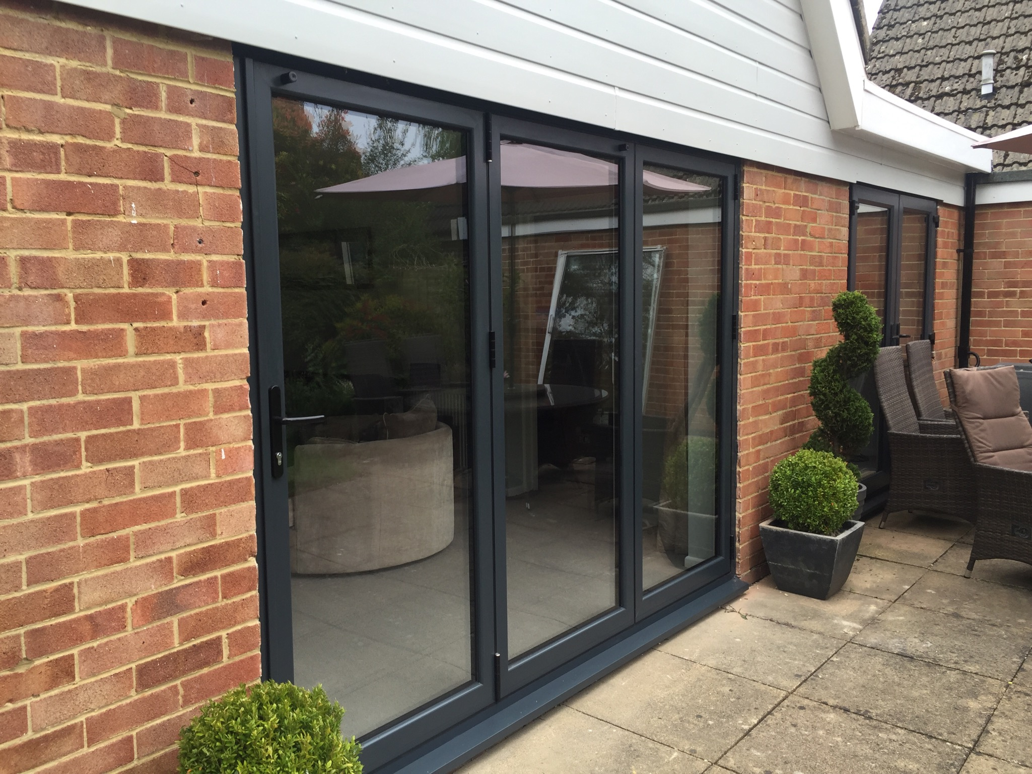 bifold door,   Guildford, Fleet, Farnham, Hook, Old Basing, Basingstoke, Oakley, Winchester, Sandhurst, Staines, Epsom, Leatherhead, Send, Woking, Wimbledon, High Wycombe, Crowthorne, Addlestone, Godalming, Aldershot, Bentley, Dorney, Burnham Common, Wokingham, Newbury, Oxford, Marlow, Basingstoke, Andover, Winchester, Romsey, Bordon, Yateley, Wasing, Reading, Chieveley, Burleigh, Barkham, Hurst, Lightwater, Windlesham, Wentworth, Sunningdale, Windsor, Chobham, Chertsey, Chilworth,