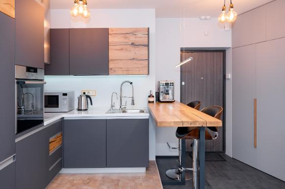 new kitchen diner in garage conversion with scaffold board breakfast bar