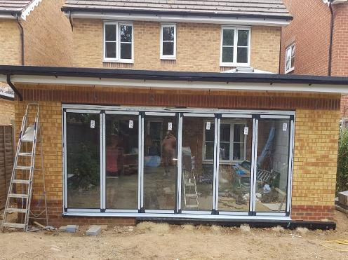 extension, bifold doors, rendering, monocouche render, orangery extension, lantern roof, timber extension, timber building, garage conversion